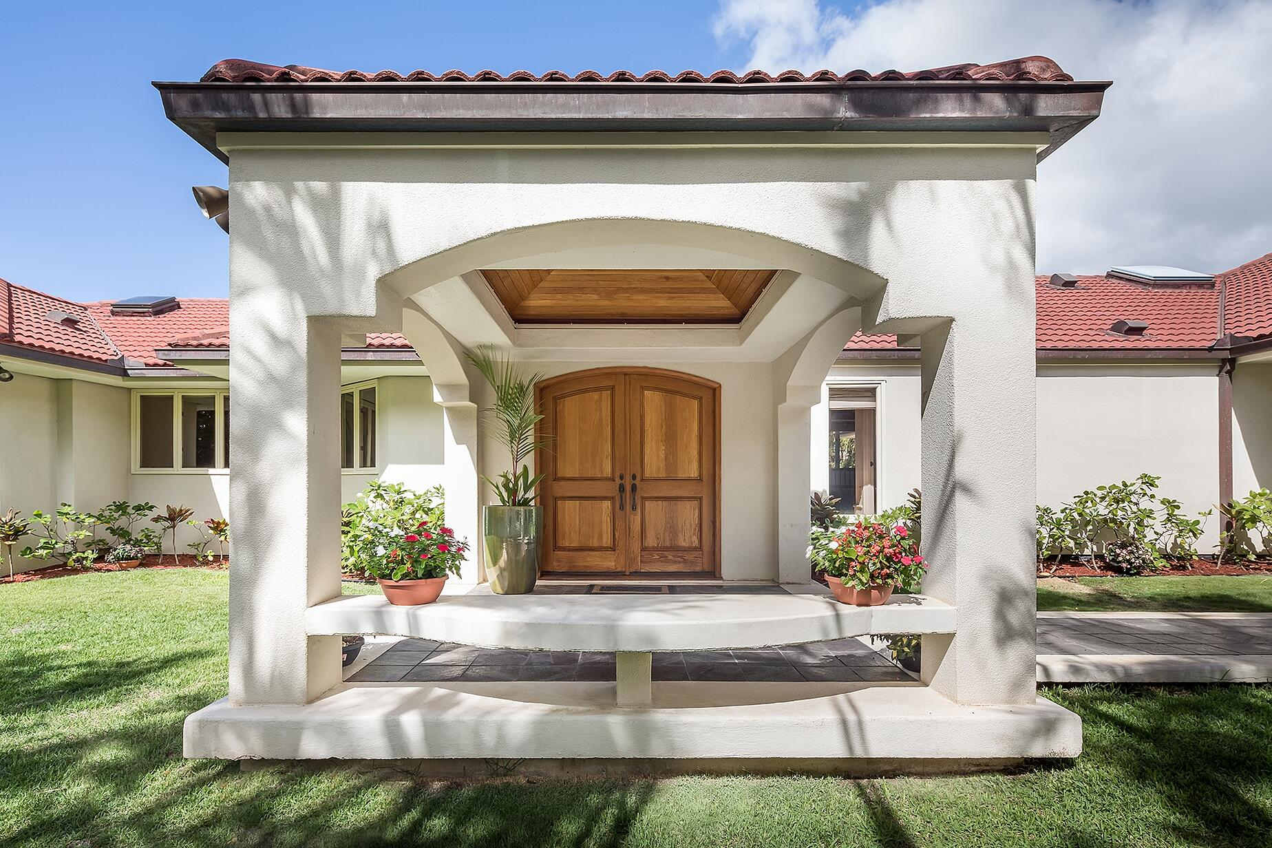 This impressive patio enclosure frames the main entrance and welcomes visitors into the home. Photograph: Mark Singer Photography