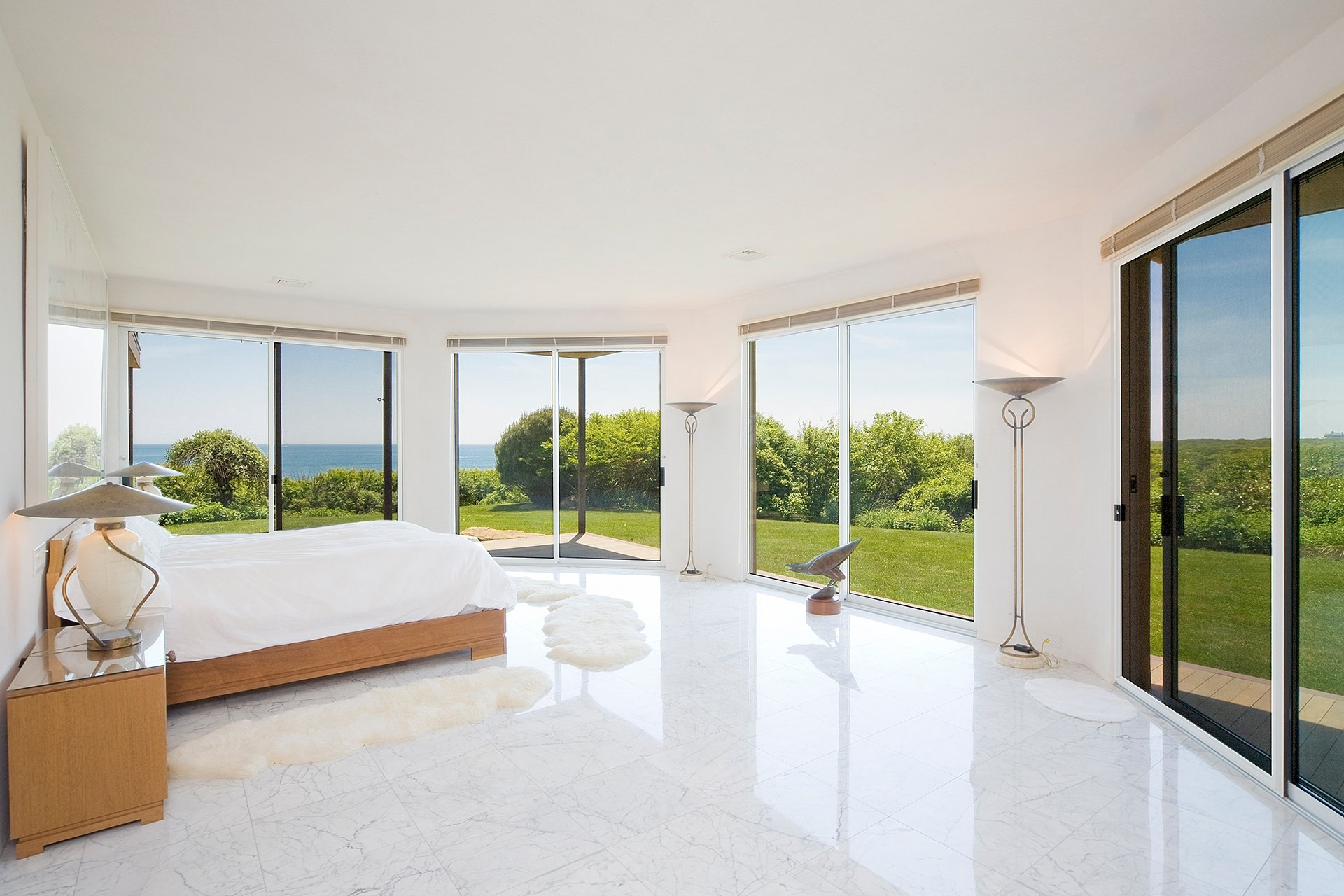 The views from the master suite are equally impressive, while floor-to-ceiling walls of glass open to lush, landscaped lawns.