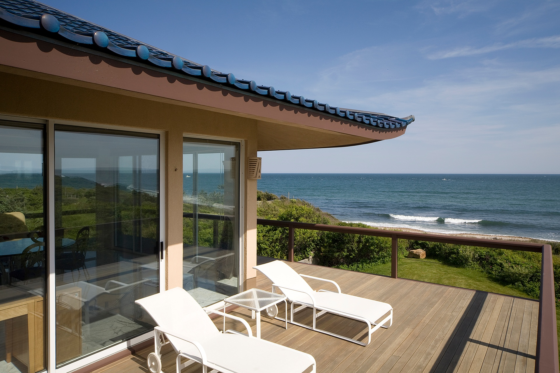 Beautiful teak decks provide plenty of spaces to relax and entertain against the dramatic backdrop of the Atlantic Ocean.