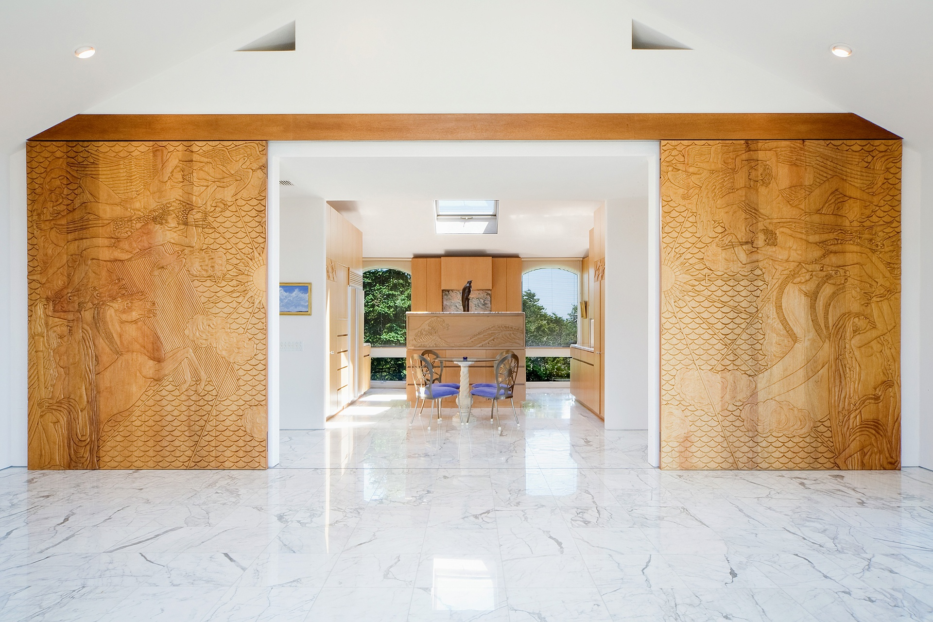 Gleaming interiors of wood, glass, and marble are a hallmark of this Montauk masterwork.