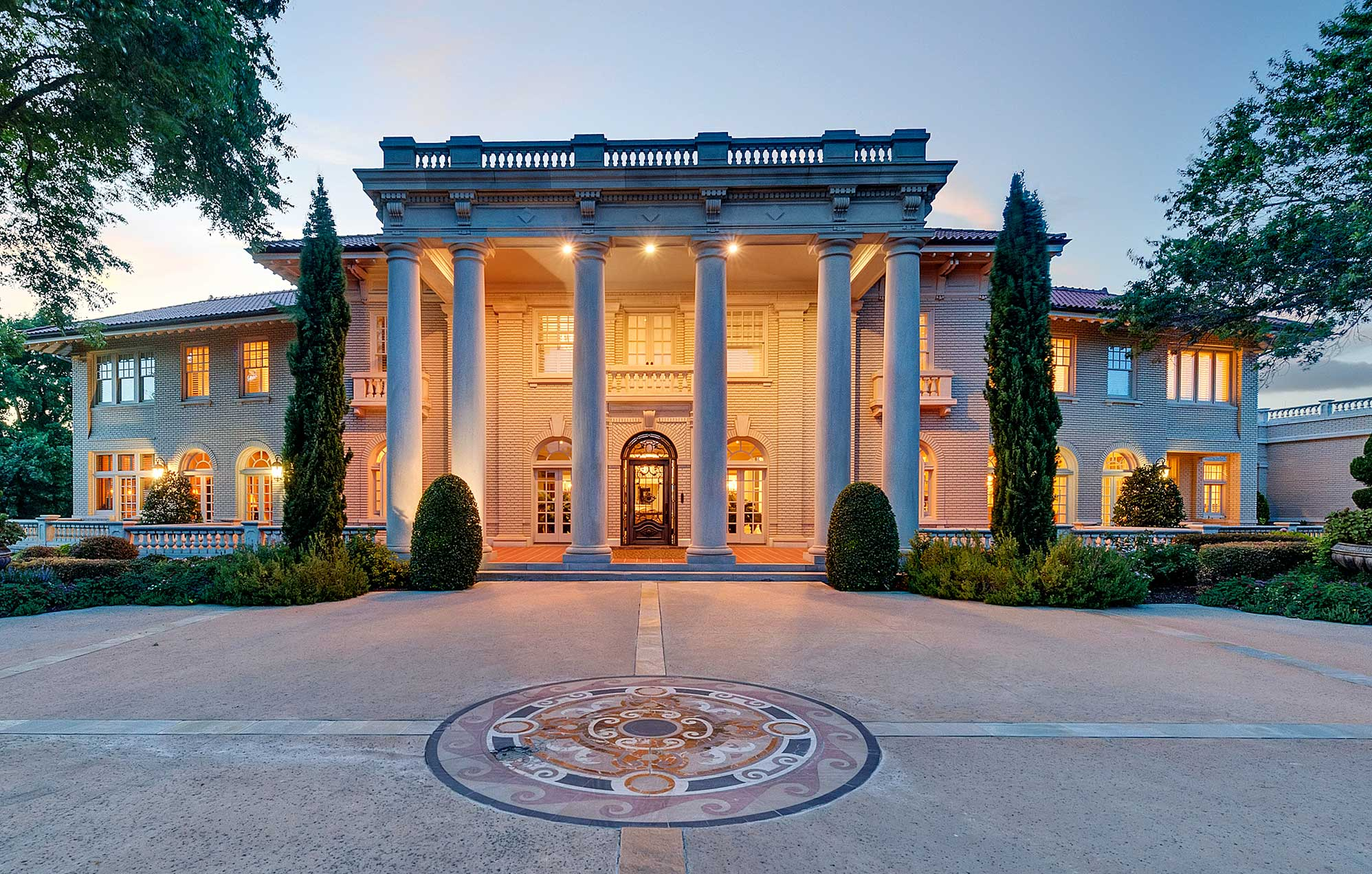 The Baldridge House, a magnificent 1.5-acre estate in Fort Worth, has a multi-vehicle garage facility with a car lift, workshop, and wash bay.