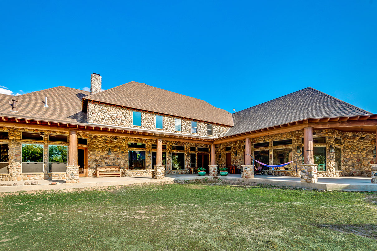 This 500-acre Texas ranch has an equine facility with custom-designed stalls, a wash bay, feed store, tack room, horse walker, and roping chutes.