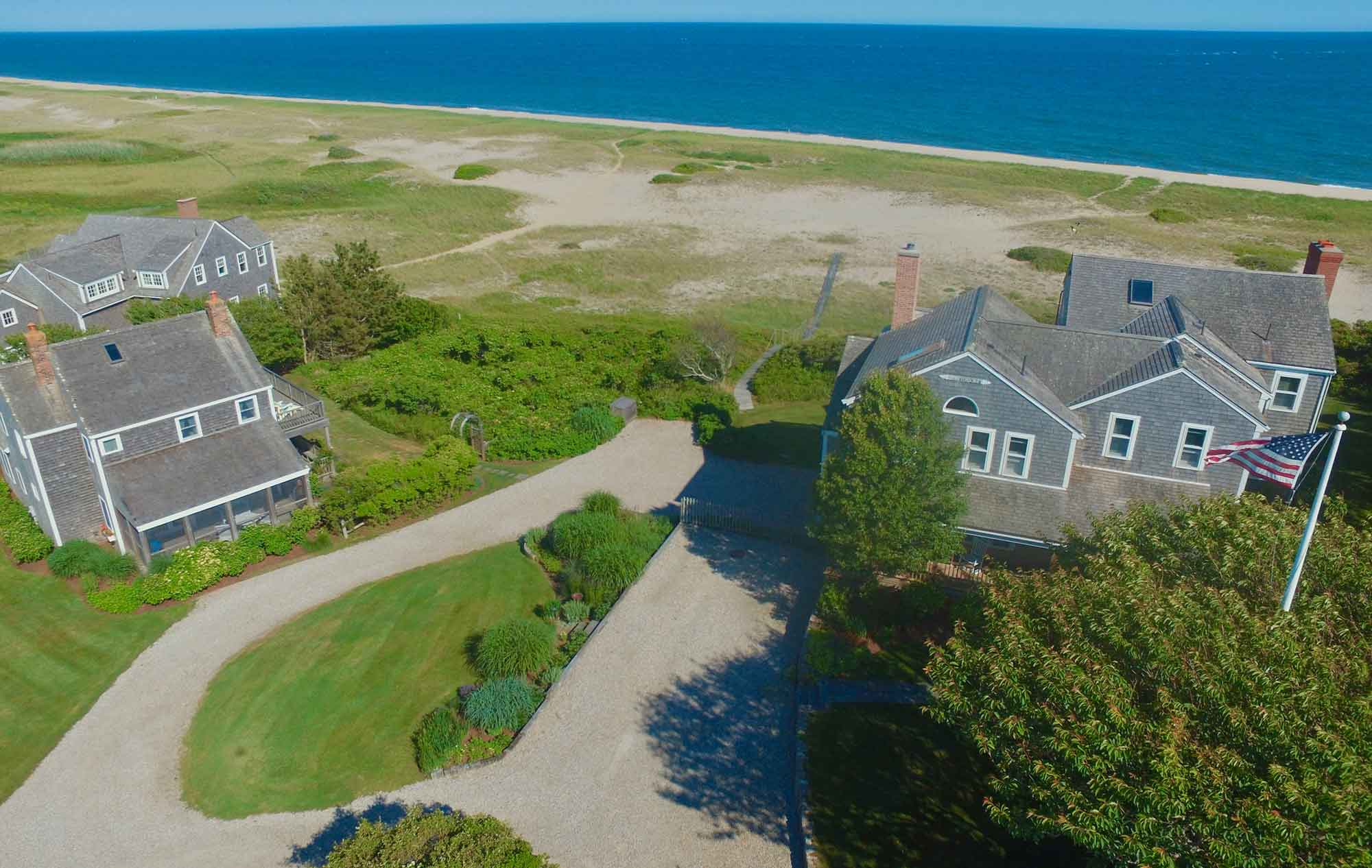 Featuring incredible ocean views, this Nantucket oceanfront retreat is surrounded by beautifully landscaped gardens, with access to a boardwalk leading past dunes to a quiet sandy beach.
