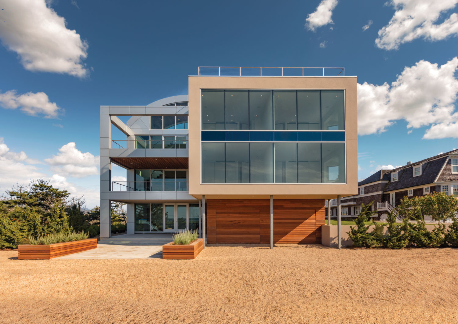 A contemporary marvel in glass and steel, with unrivaled views of the Atlantic Ocean and Shinnecock Bay, provides Hamptons living at its finest.