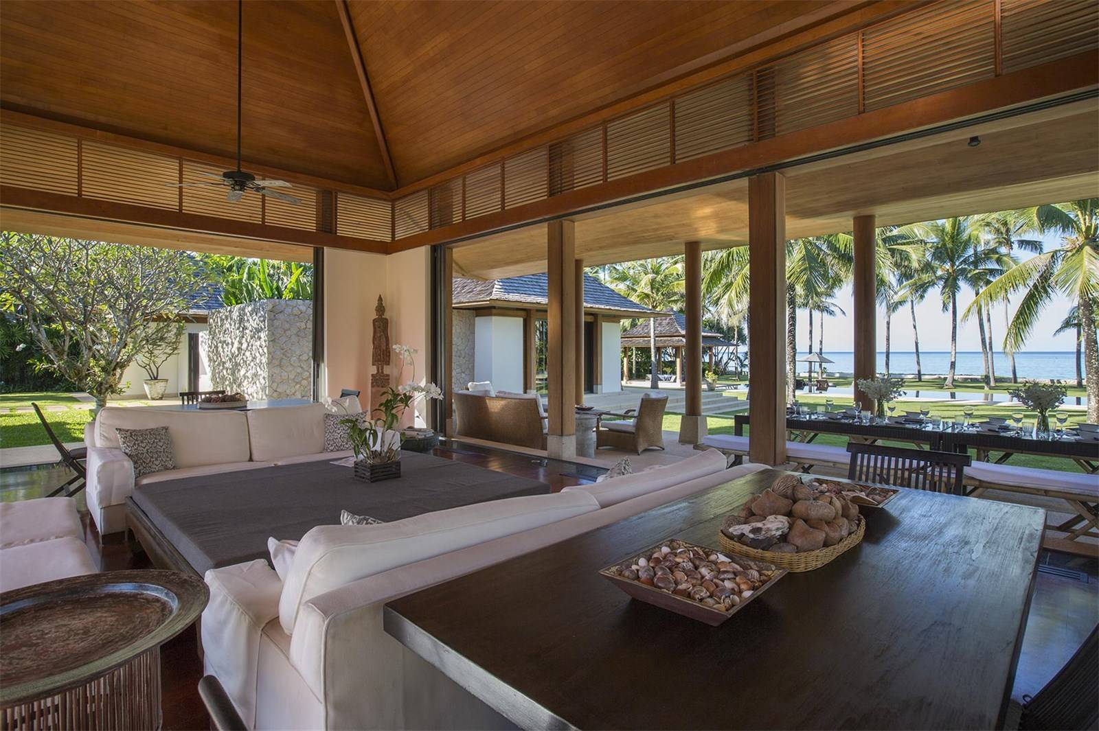 Interiors blend classic Thai accents of teak and bamboo with contemporary flourishes.
