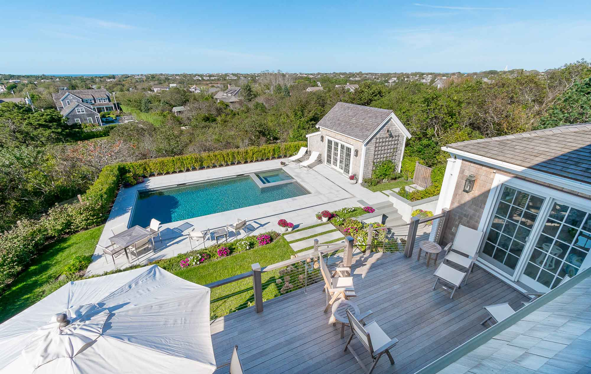 Carefully rebuilt in 2015, this Nantucket hilltop estate incorporates a modern, open-concept layout combined with custom-designed details throughout.