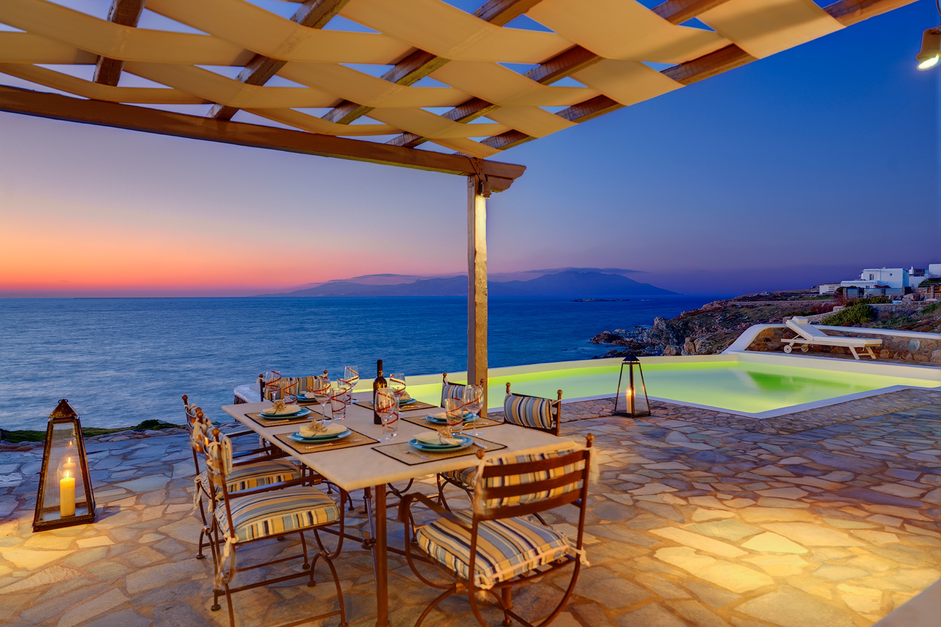 """The terrace pool and its Aegean backdrop serve as a """"beach substitute"""" in the evening hours."""