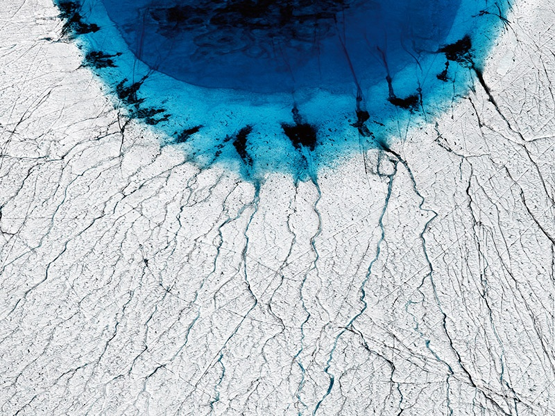 "UK-based photographer Timo Lieber describes <i>THAW #1</i>, his image of a deep-blue lake on the ice cap of Greenland, as an eye, ""almost as if global warming is looking right back at us."" Banner image: Todd Kennedy's dreamlike photograph of a rock pool in Sydney at high tide."