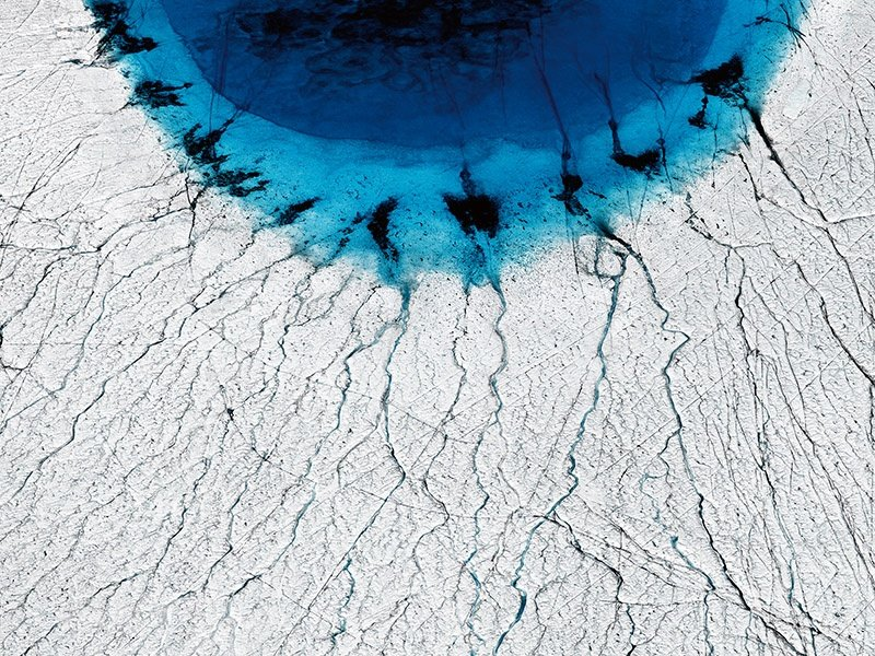 """UK-based photographer Timo Lieber describes <i>THAW #1</i>, his image of a deep-blue lake on the ice cap of Greenland, as an eye, """"almost as if global warming is looking right back at us."""" Banner image: Todd Kennedy's dreamlike photograph of a rock pool in Sydney at high tide."""