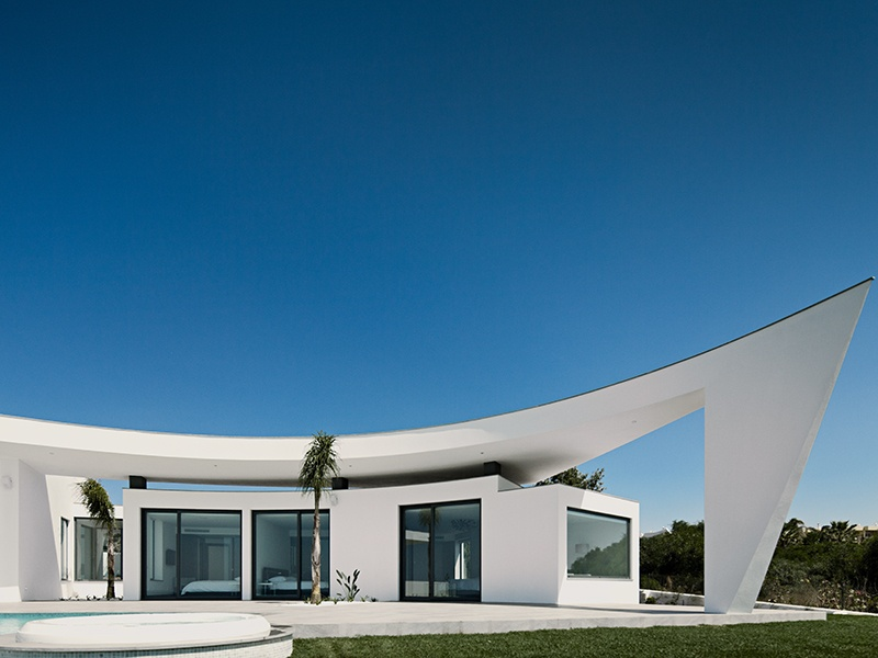 The five-bedroom Colunata House, again in Luz, Portugal, is situated on one striking level and made up of a set of organically grouped white buildings.