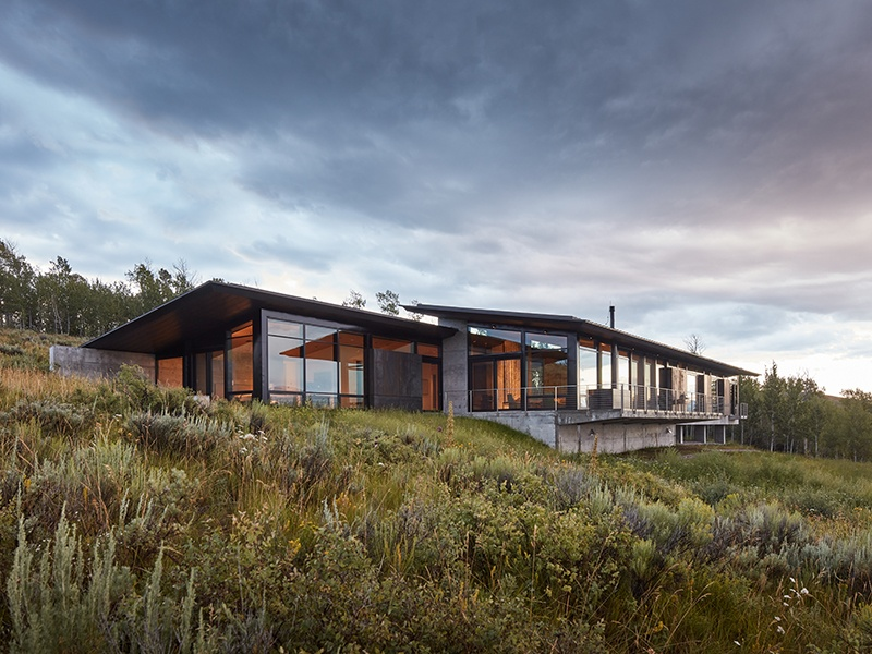 Nestled against the Teton mountain range, Abramson Teiger Architects' Wyoming residence takes advantage of the weathering qualities of Cor-ten steel, allowing the building to harmonize with the surrounding natural landscape and offering a maintenance-free environment.