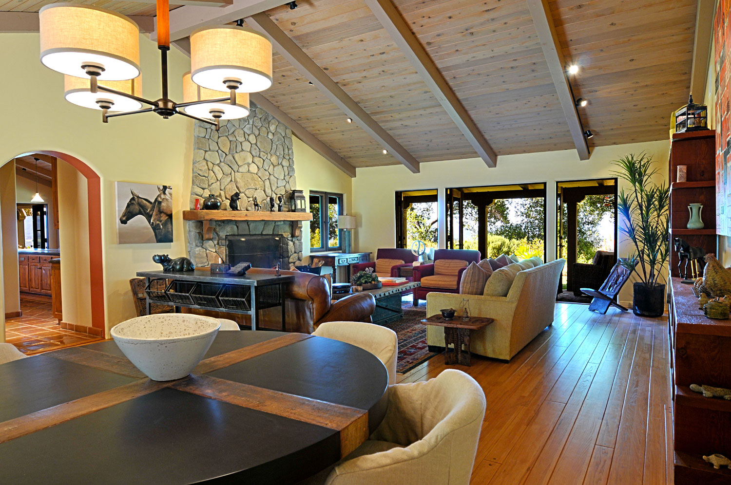 Interior living spaces have been renovated with vaulted ceilings to lend openness to the home.