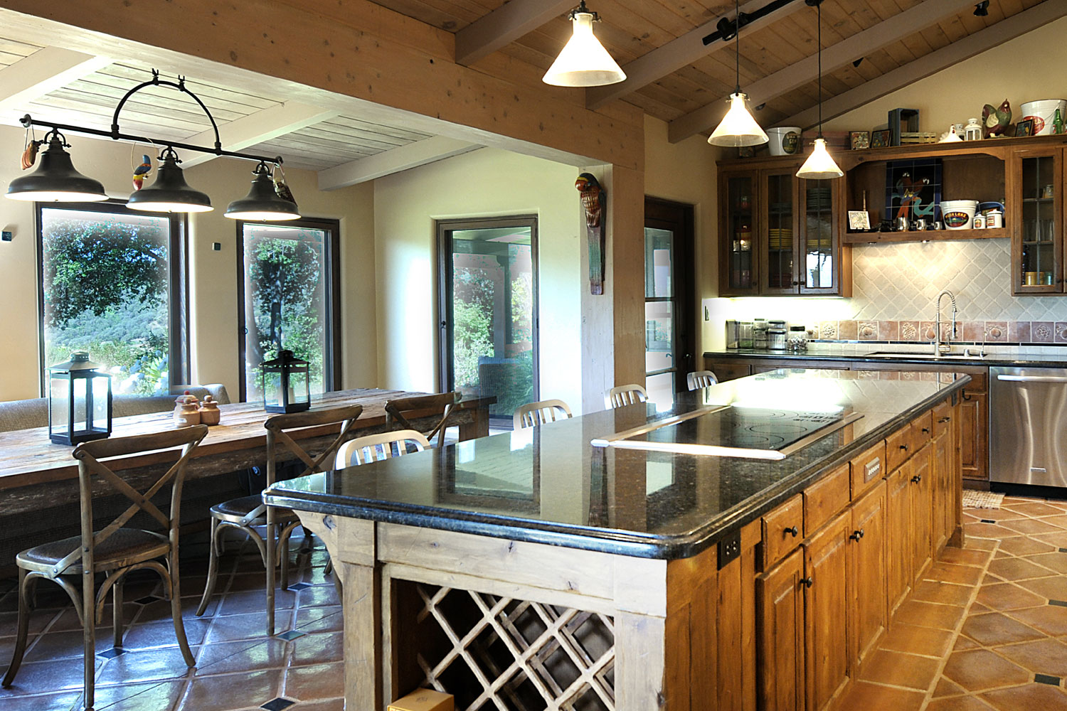 A modernized kitchen is notable for its openness and natural lighting.