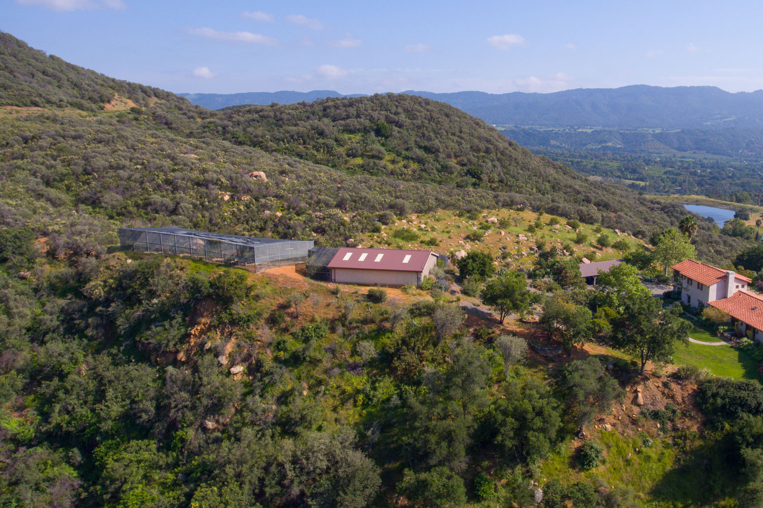 This aerial vantage offers a look at the property's  state-of-the-art aviary at left.