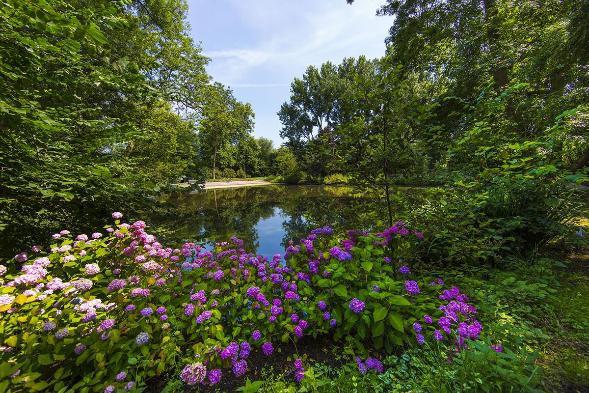 This 5.5-acre grounds are a sanctuary of seclusion with mature gardens and a natural swimming pool, yet are close to the historic center of Amsterdam.