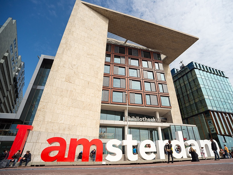 Amsterdam's Central Public Library, designed by Dutch architect Jo Coenen, is more than a library, housing a theater, broadcasting studios, exhibition rooms, a café and a panoramic terrace.