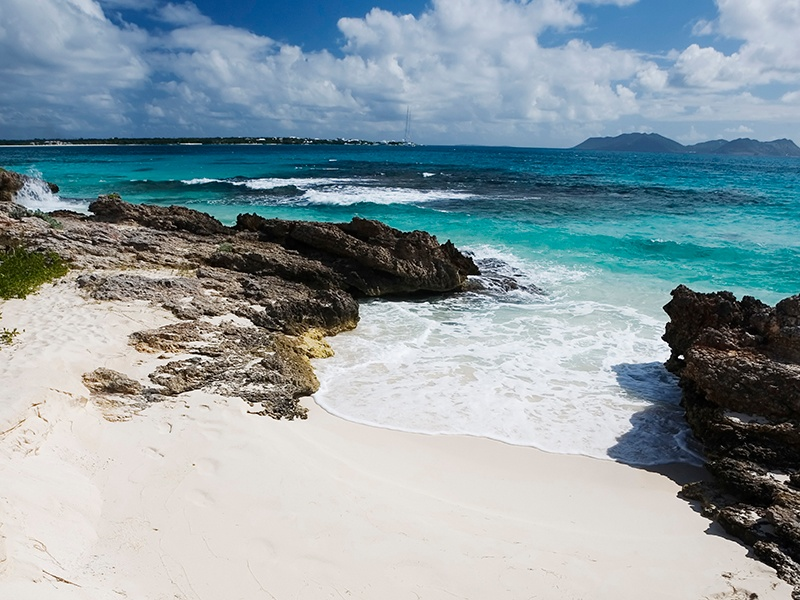 A perfect crescent shape, Rendezvous Bay beach has a rugged area at its western end. Photograph: Getty Images