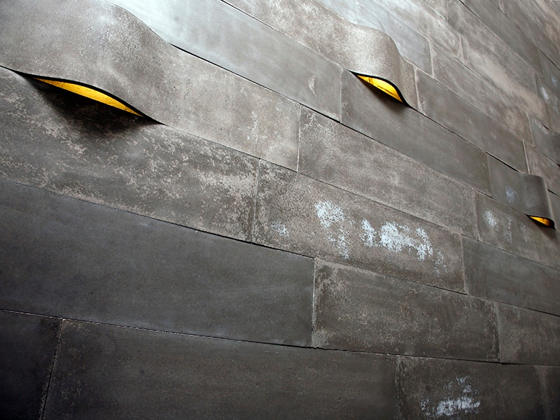 Itai Bar-On, a Tel Aviv-based designer, uses unique materials for the concrete tiles that seem to peel or bubble off a wall, and which can be backlit.