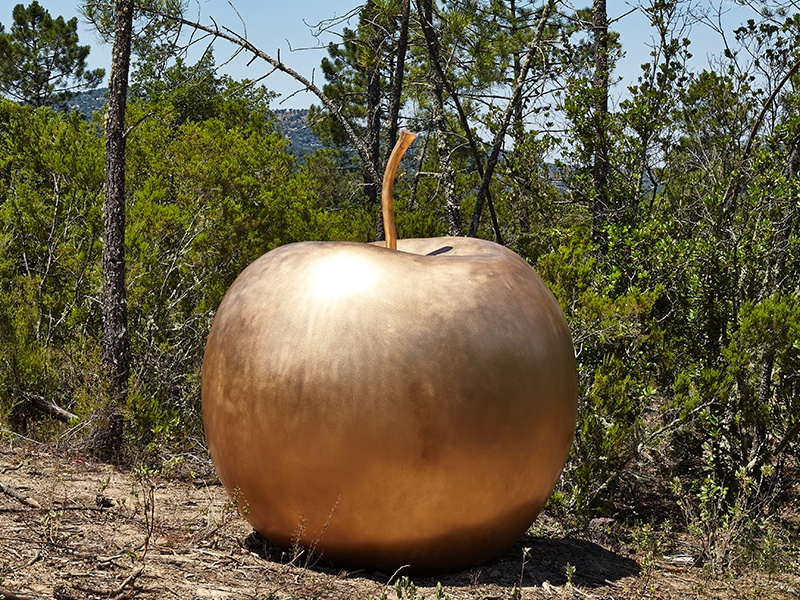 Claude Lalanne's oversized bronze apple, <i>Pomme de New York</i> at Domaine du Muy in the South of France. © Claude Lalanne. Courtesy Domaine du Muy. Photograph: JC Lett.