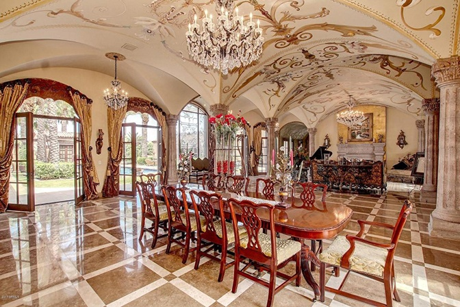 This palatial residence is in the beautiful desert community of Paradise Valley, Arizona, but its ornate, styled interiors take their cue from the Italian Renaissance.
