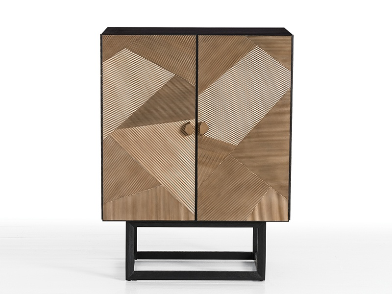 Jay Jeffers has collaborated with Arteriors on a collection of furniture, lighting, and other home accessories, including the chic black and gold Gatsby Cocktail Cabinet.