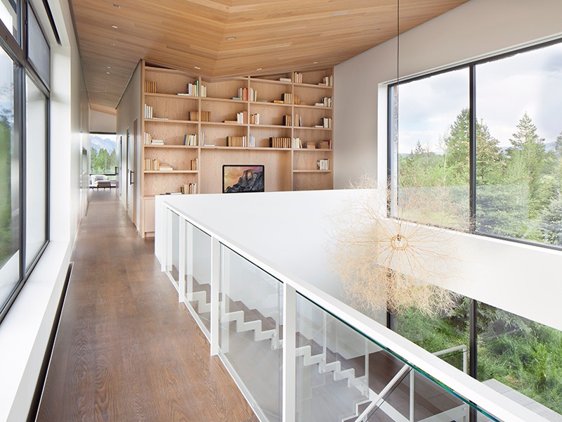 A gallery runs the whole length of the upper floor, which features a master suite with dual baths, an office, and a library. Photograph: Gibeon Photography