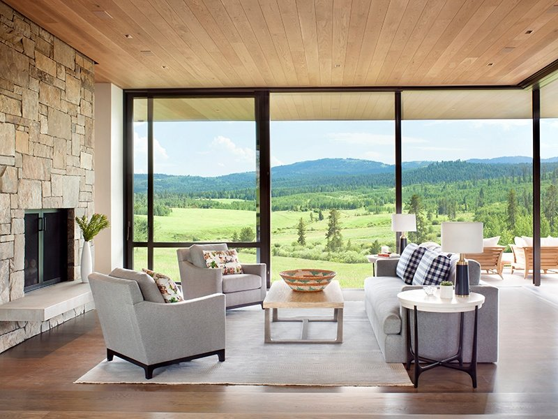 The main living space has floor-to-ceiling glass walls that roll back to invite the outdoors in. Photograph (and banner image): Gibeon Photography