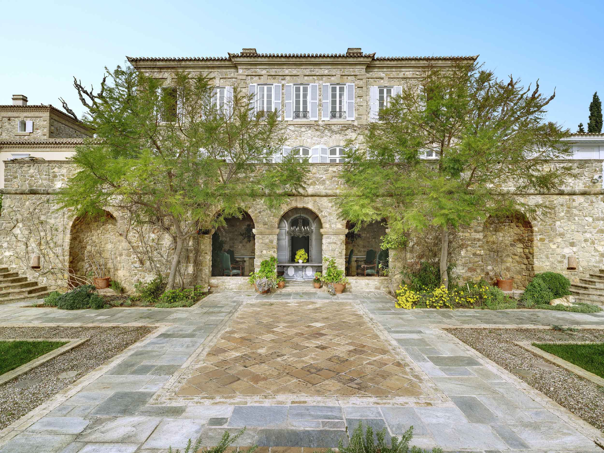 Perched on a hill in the Athenian countryside, Villa Mareza is a grand provençal-style stone villa surrounded by nearly nine acres of grounds with neoclassical gardens and resort-worthy features.