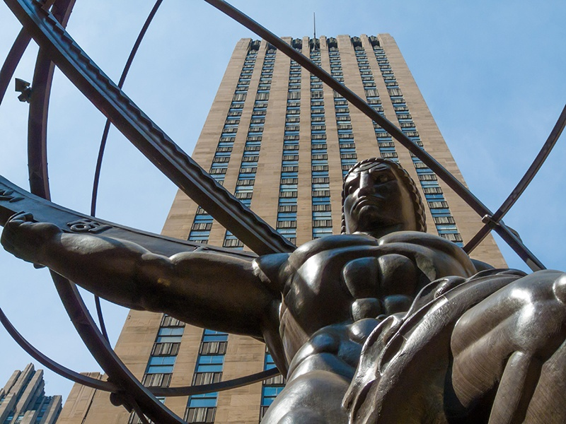 A collaboration between Lee Lawrie and Rene Chambellan, <i>Atlas</i> (1937) stands at 630 Fifth Avenue, in front of Rockefeller Center's 41-story International Building. Photograph: Alamy