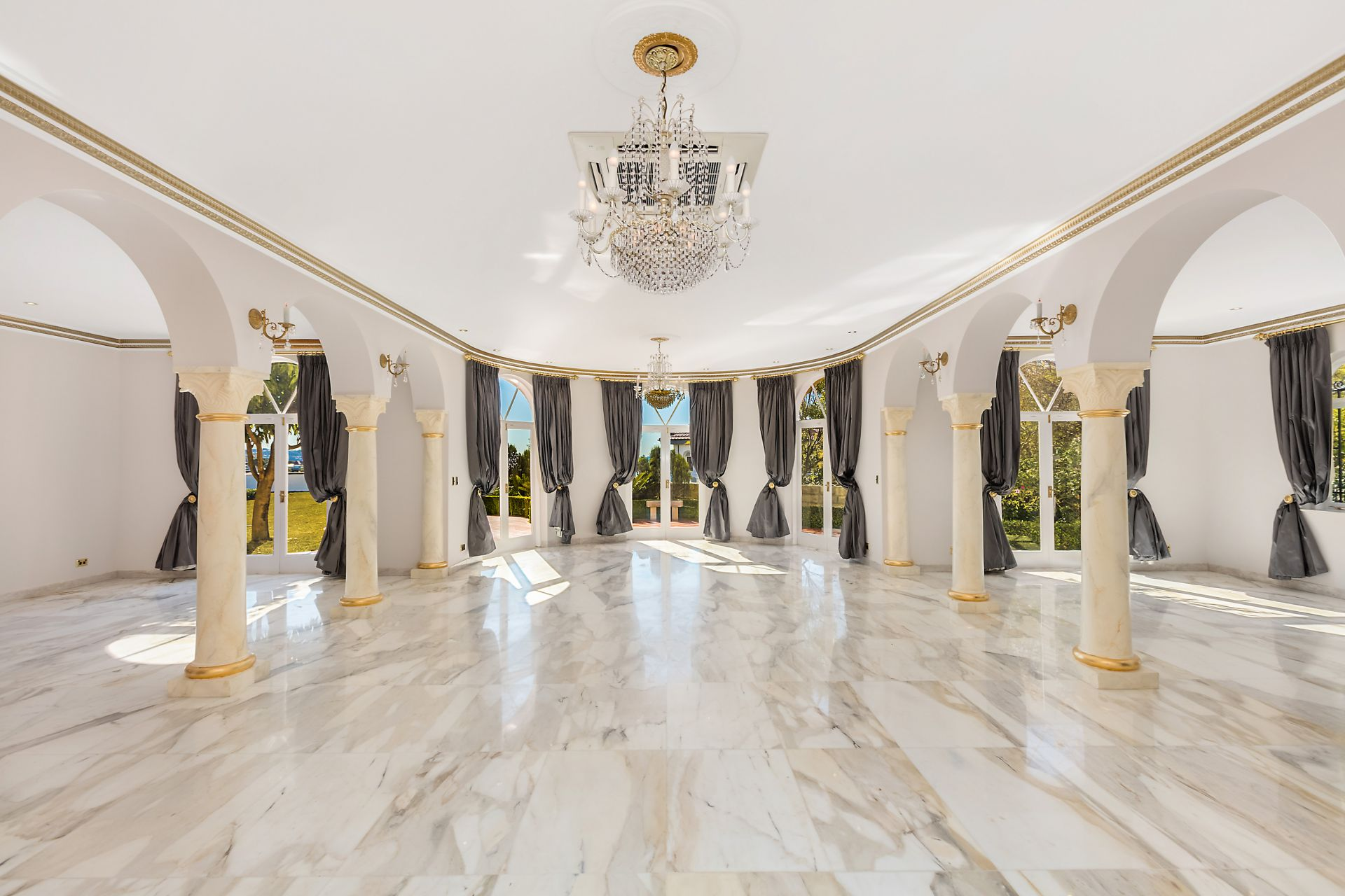 Alcooringa, a magnificent 1930s estate overlooking Sydney Harbour, has a number of fashion-friendly features, including a grand ballroom with Italian chandeliers and marble floors.