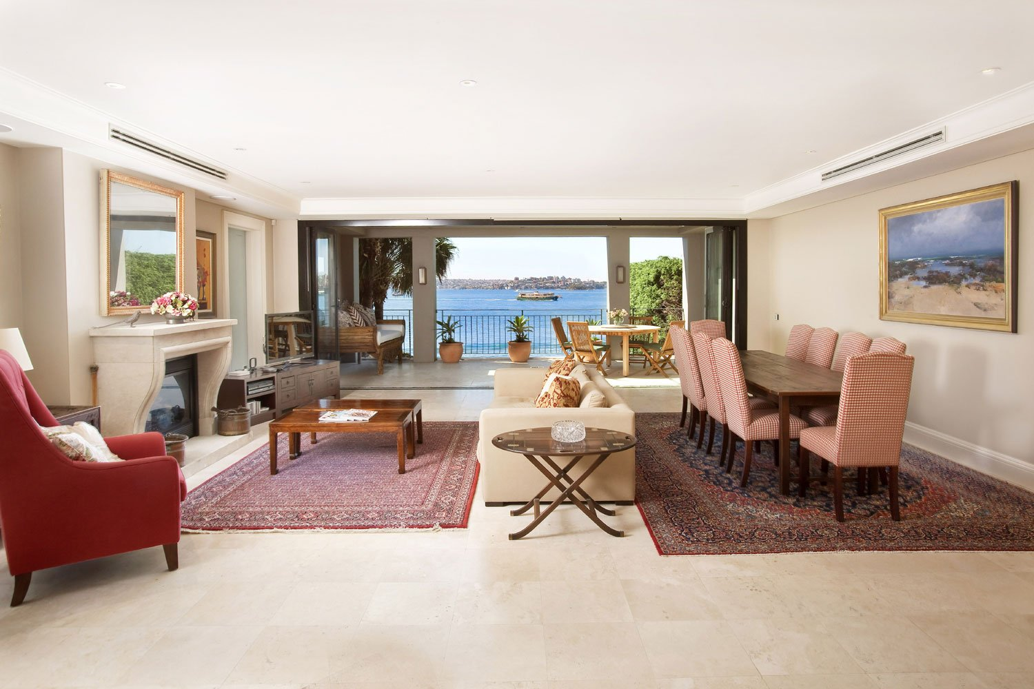 In Sydney, Australia, this home enjoys a prime waterfront position in one of the city's finest suburbs. It benefits from elegant living spaces and breathtaking Sydney Harbour views.