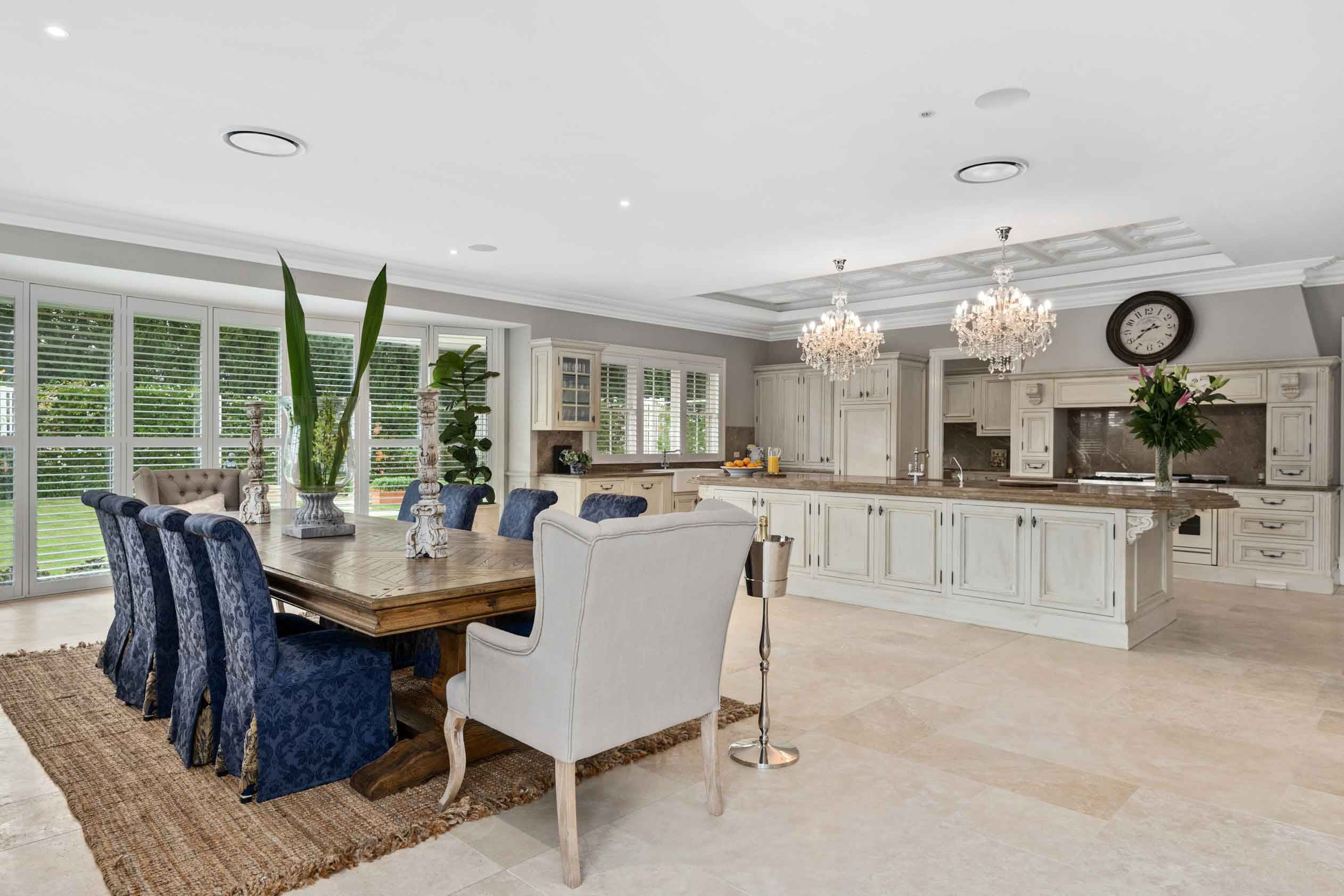 This Sydney home offers seclusion, space, and luxury in equal measure. The beautiful Provençal-style kitchen has top-drawer appliances and refined touches, including two crystal chandeliers.