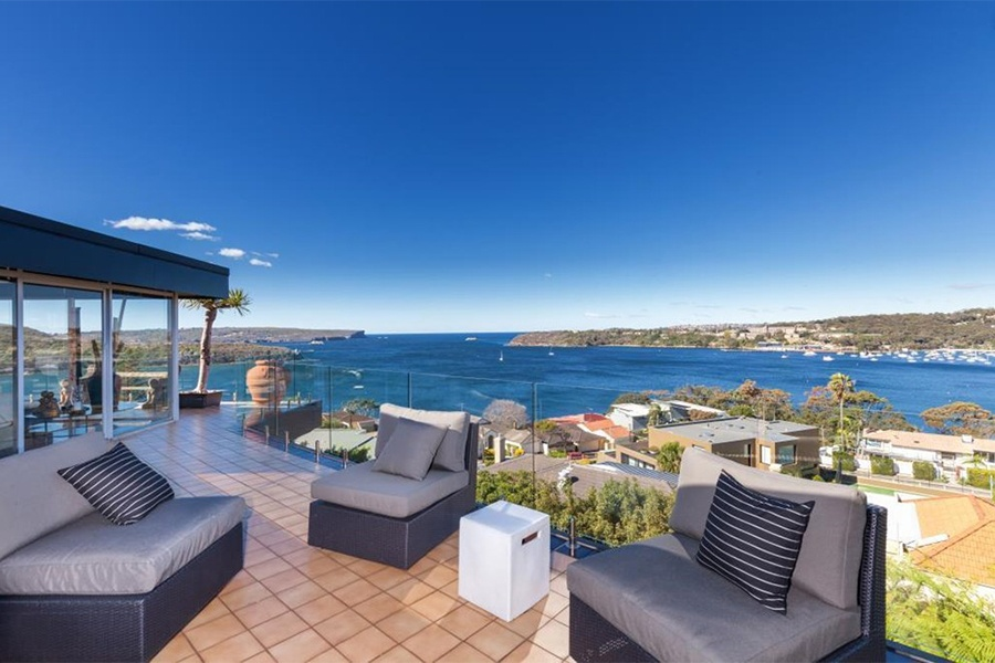 This seven-bedroom estate in Sydney's Balmoral district reflects the best of Sydney with its water views, proximity to the shore, and modern yet inviting design.