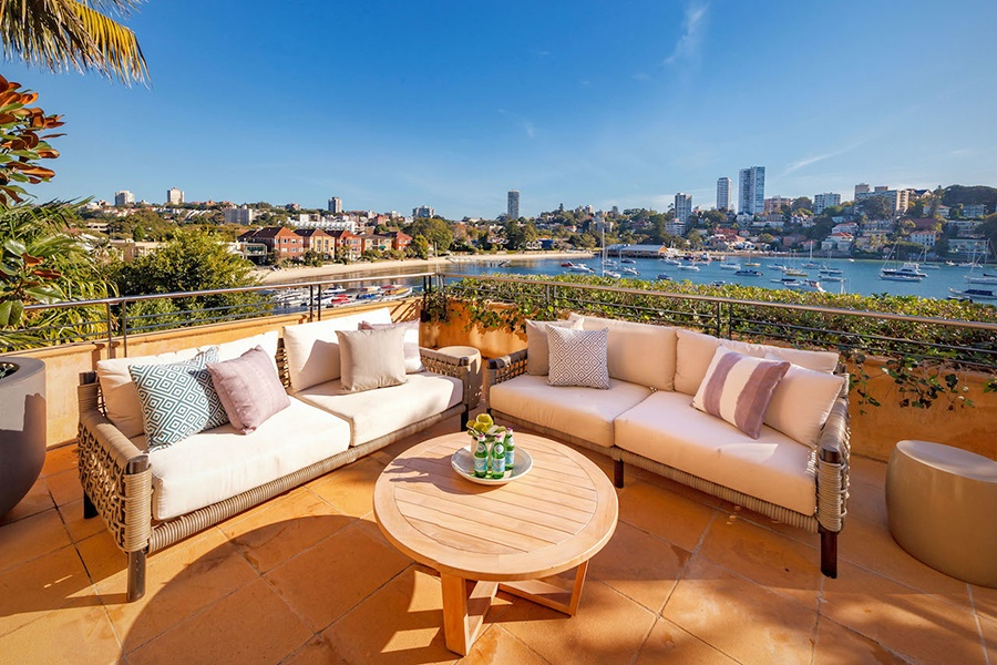 Sydney's famed harbor and skyline create an enviable view from the balcony of this condominium in the historic Gladswood House on the waterfront.
