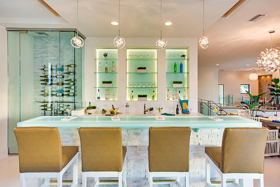 A modern loft bar with lit glass and walk-in glass climate-controlled wine keeper are among the many highlights of this new waterfront residence in Bradenton, Florida