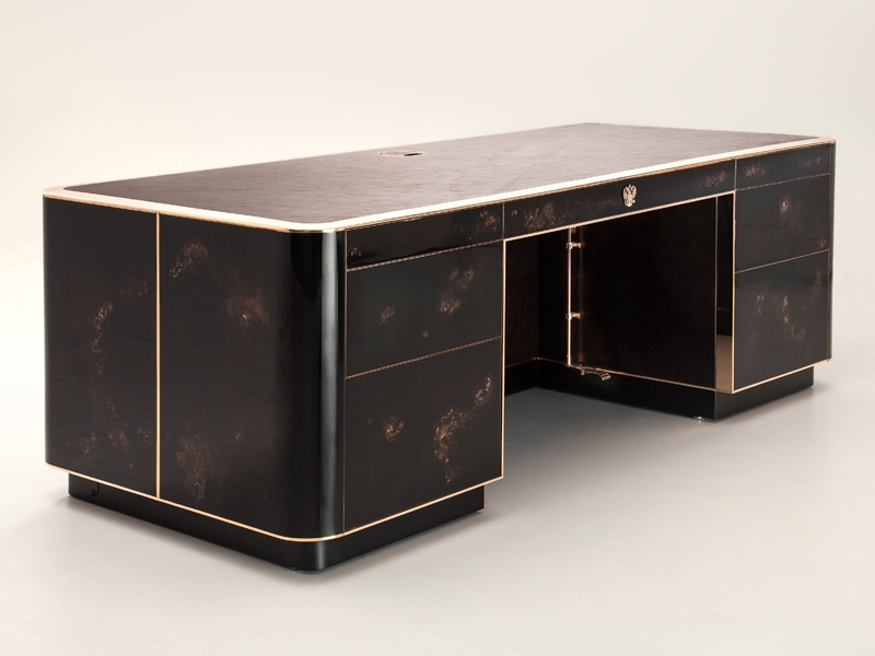 "Commissioned in celebration of a birthday, this commemorative desk – a ""functioning artwork"" – was hand-built by Based Upon artisans and designed to ""reveal a different strand of life narrative each time a drawer is opened or the desk approached."""