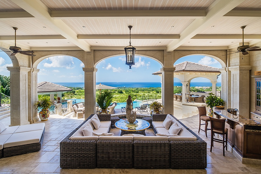 With its swim-up bar, poolside covered terrace with bar, and multiple outdoor dining and lounge areas, this tropical estate serves up numerous options for entertaining and enjoying spectacular ocean views.