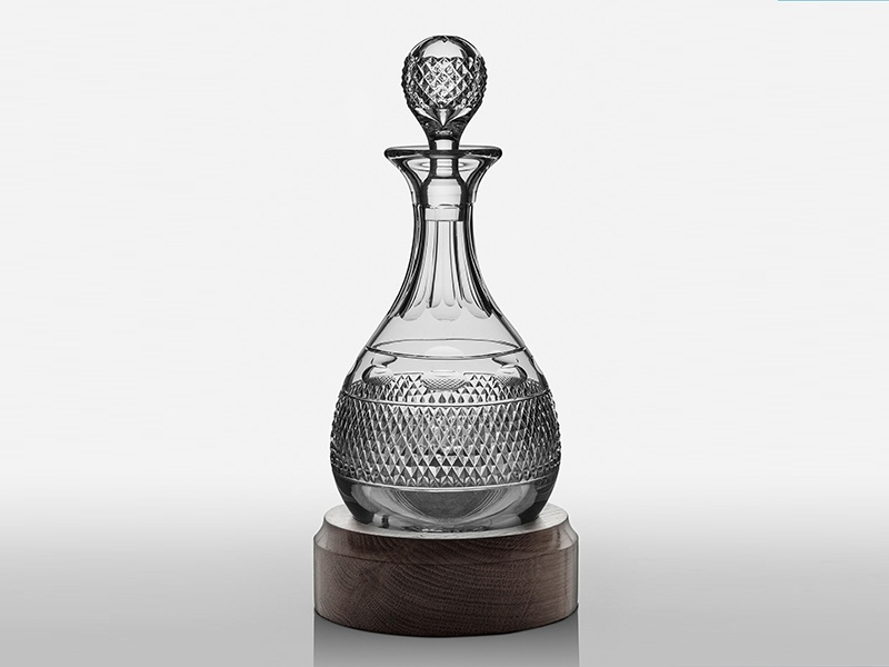 Perfect for displaying port, Amara's Grasmere Hogget Decanter has a rounded bottom and hand-carved wooden base.