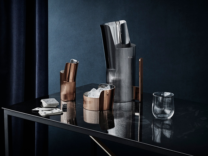 Mirror polished surfaces unite with ribbed steel in Georg Jensen's Urkiola collection, which includes bowls and pitchers. Banner image: Baccarat's Louxor decanter and glasses.