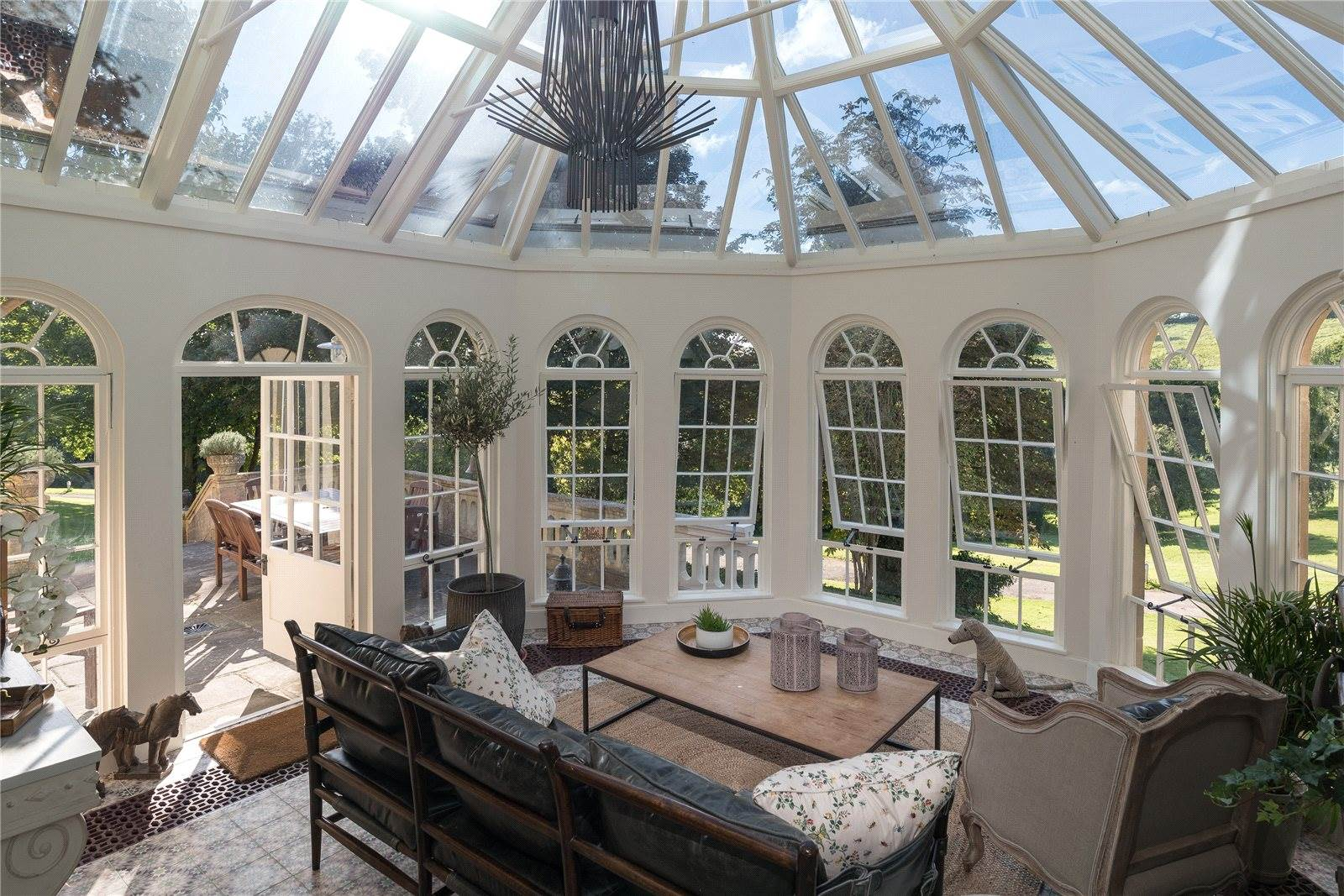 Kelston Knoll House is a Grade II listed Italianate manor with scenic views of the River Avon and the Somerset countryside. At the rear of the house is a wonderful orangery with under-floor heating for year-round use.