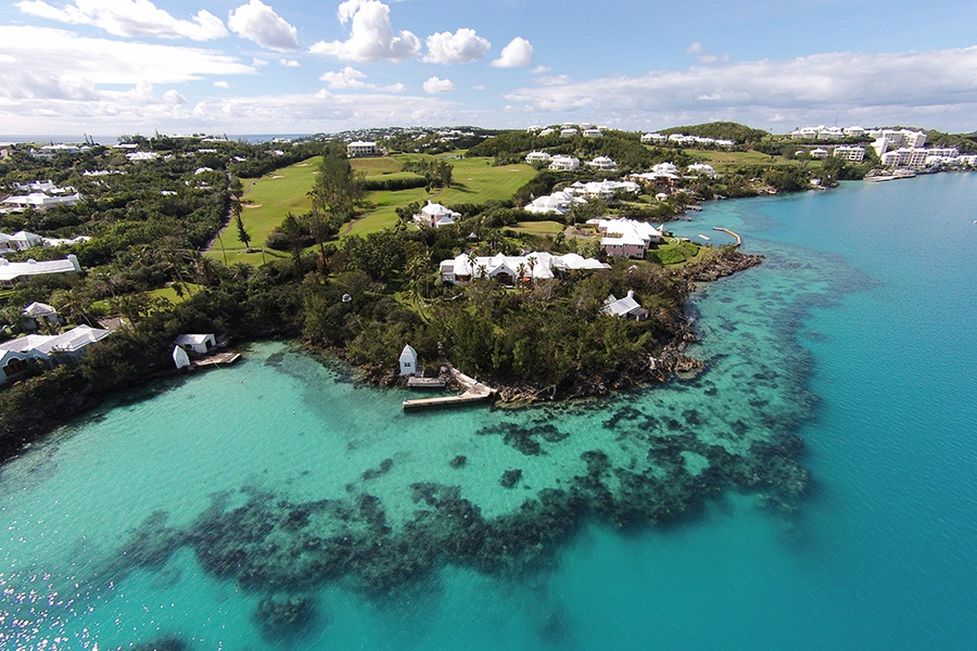Shimmering turquoise waters and pink sand beaches are the hallmarks of Bermuda, and this Tucker's Town estate offers immediate access to the island's aquatic activities such as sailing—and golf.