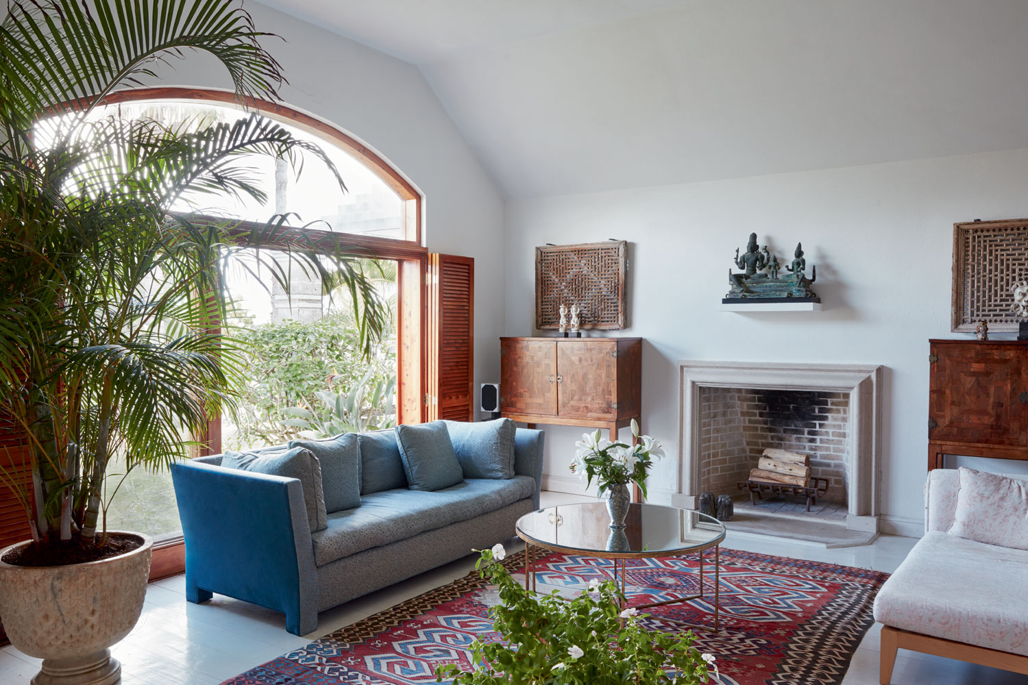 Finishes inside the residence add an elegant, international twist to the authentic island architecture, from English cabinetry and stone fireplaces to Moroccan-style marble mosaics.
