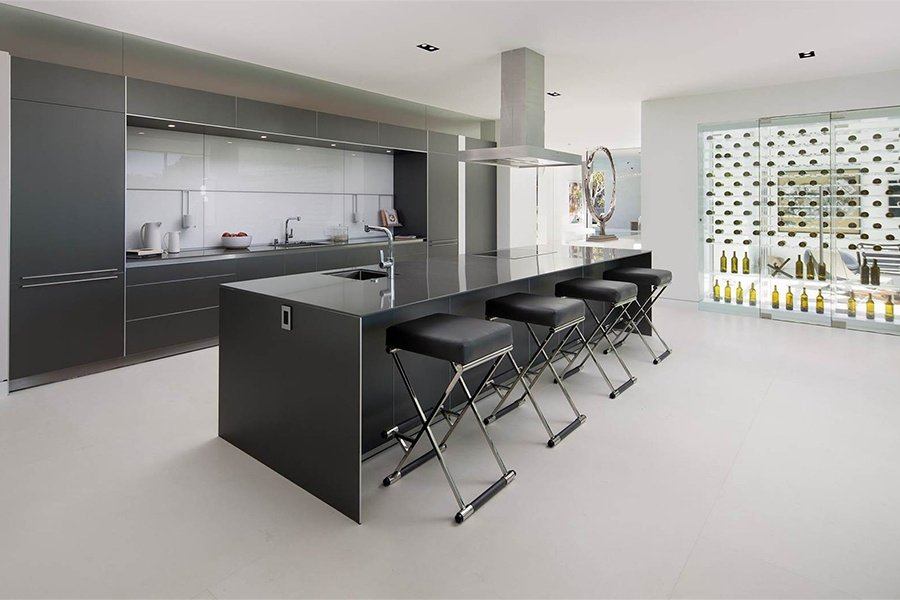 Party guests and family members alike will feel a special thrill dining or simply lounging in this Beverly Hills kitchen with its ultra-modern furnishings, appliances, and Lucite wine storage cube.