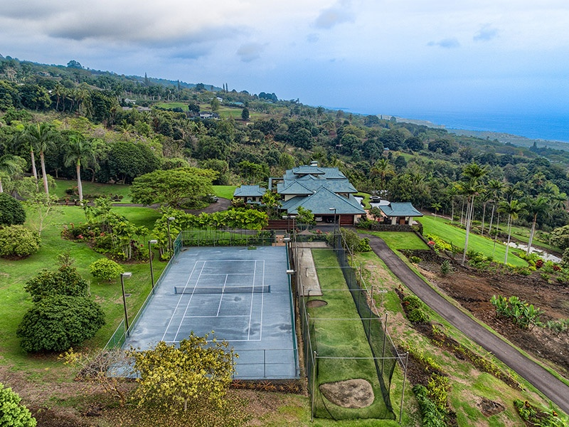 Two pools, a spa, bocce court, driving range, and a tennis court provide plenty of opportunity to keep fit and to relax at this well-appointed Hawaiian estate. $14,500,000. On the market with Hawaii Life, Christie's International Real Estate's exclusive affiliate in Hawaii.