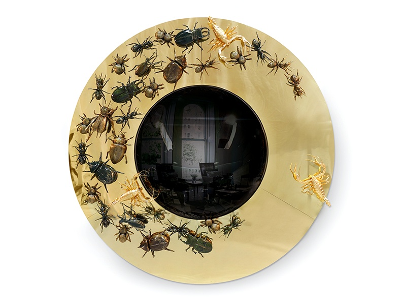 The thrill of the chase: Portuguese firm Boca do Lobo has created a mirror that plays on the concept of evolution, with the insects seeming to chase each other around the handmade frame.
