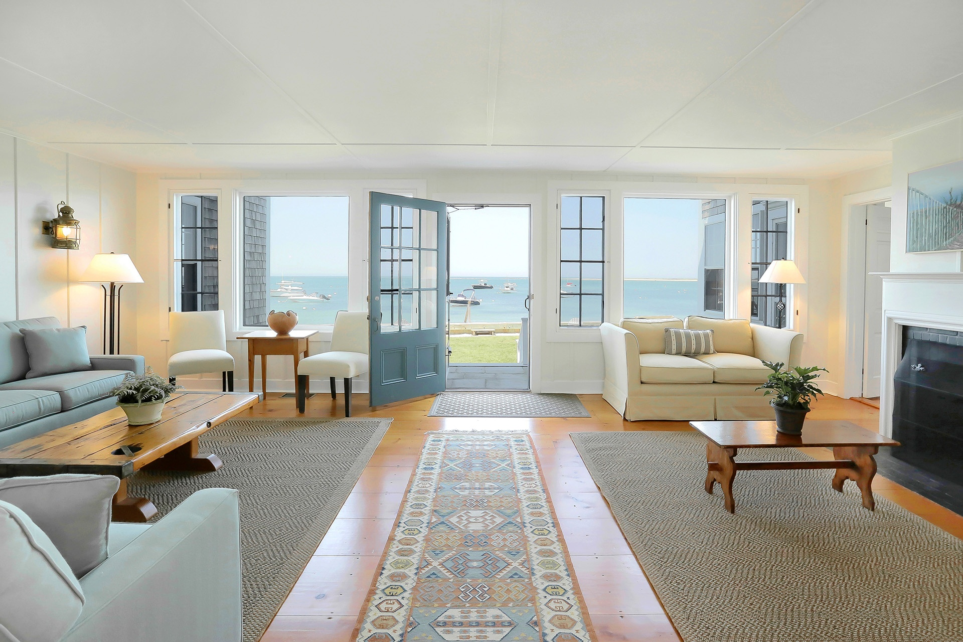 Nantucket Harbor is the picture-postcard location for this shingle-style cottage on  Brant Point.