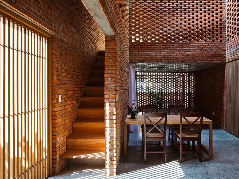 The large, multipurpose living area of Termitary House, in Da Nang, Vietnam, features open brickwork, which facilitates communication and keeps the home cool. Photograph: Hiroyuki Oki