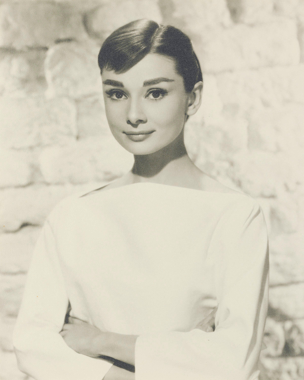 <b>FUNNY FACE (1956)</br>BUD FRAKER (1916-2002)</br><em>Audrey Hepburn</em>, 1956</b></br> gelatin silver print</br> stamped Paramount Studio credit (verso)</br> 13 3/8 x 10 ¼ in. (34 x 26 cm.)</br> Estimate: £800-1,200