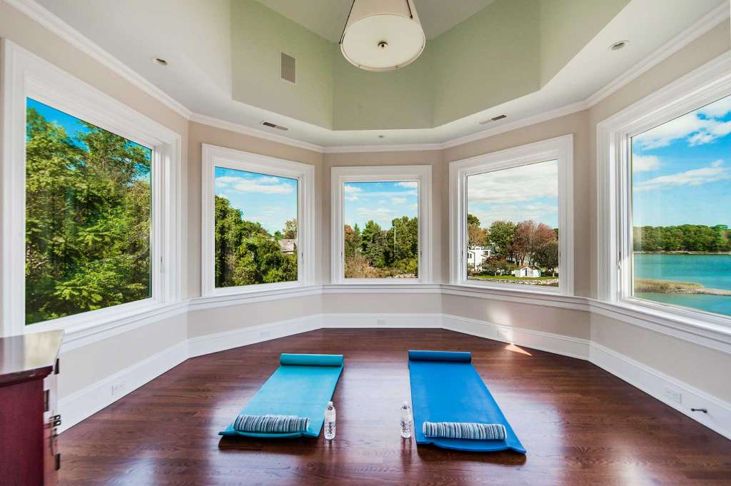 The yoga room's panoramic shoreline view is one of many Long Island Sound exposures afforded by this elegant coastal mansion.