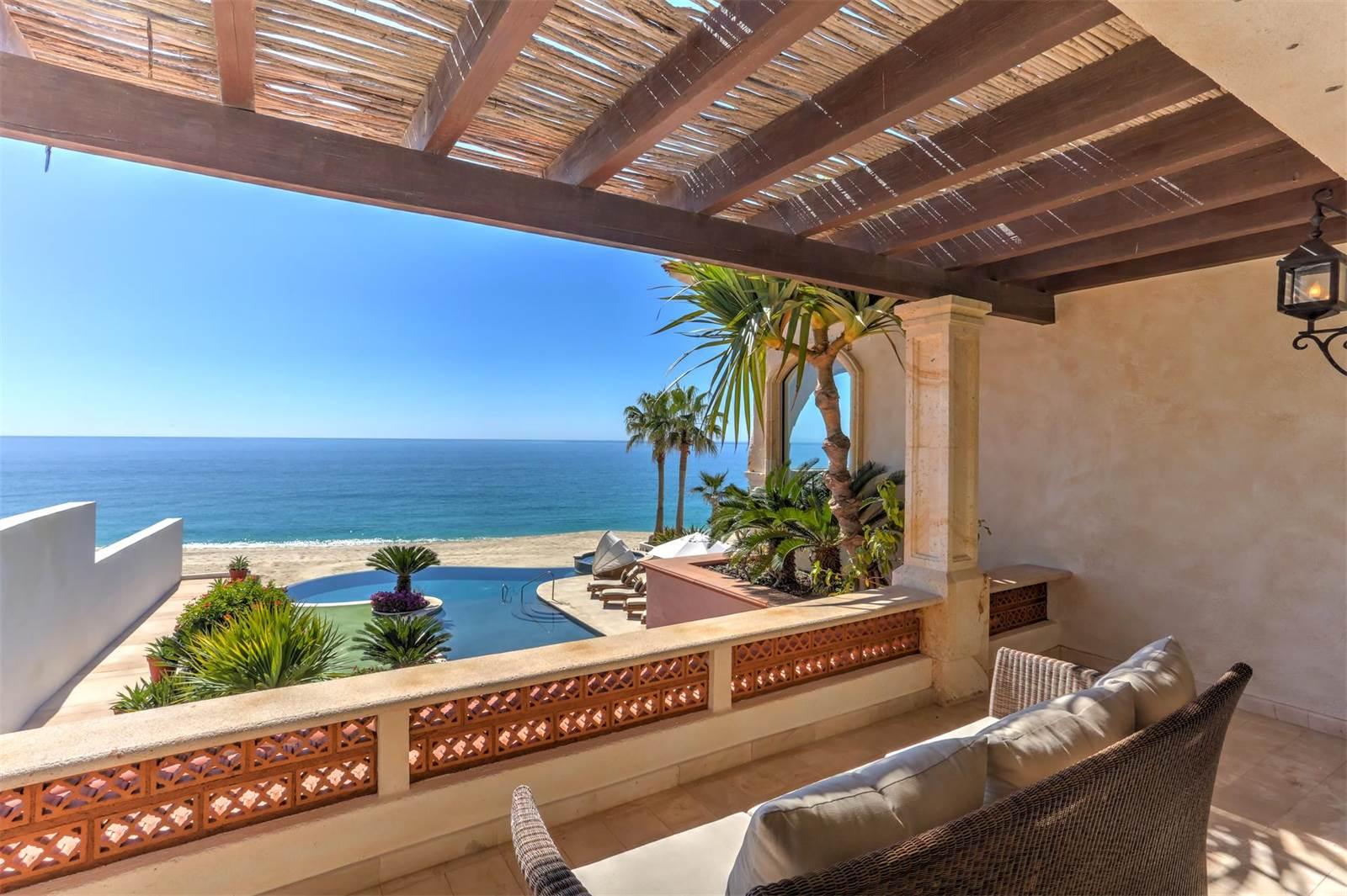 Cabo San Lucas' baronial Mediterranean home enjoys a dazzling beachside terrace.